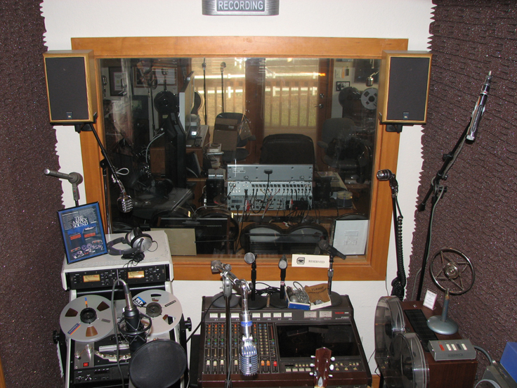 Vocal booth and display area looking into studio control room