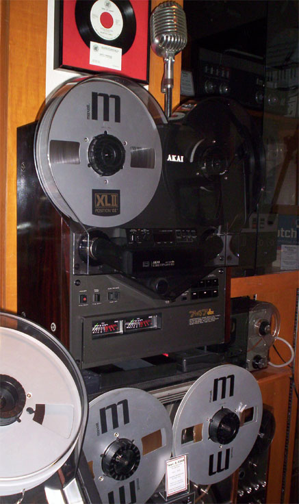 picture of the Akai GX-747 with its dust cover in Phantom's reel to reel tape recorder collection