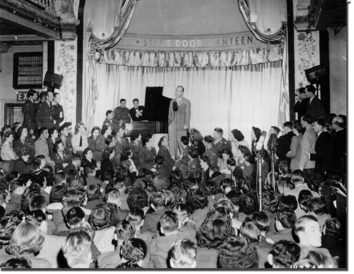 1944 picture of Bing Crosby entertaining the troops in London